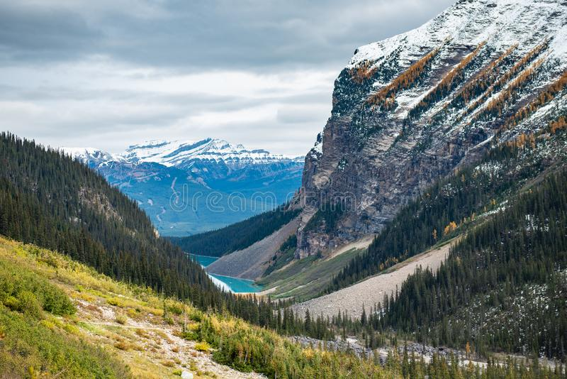 Lake Louise hiking in fall. Scenic Autumn views of the Lake Louise area and hiking PLAIN OF THE 6 GLACIERS in Banf National Park Alberta Canada stock photos