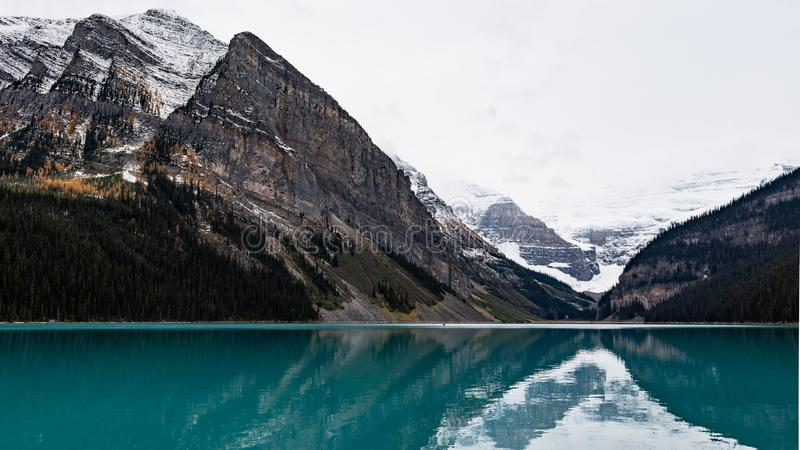 Lake Louise hiking in fall. Scenic Autumn views of the Lake Louise area and hiking PLAIN OF THE 6 GLACIERS in Banf National Park Alberta Canada royalty free stock image