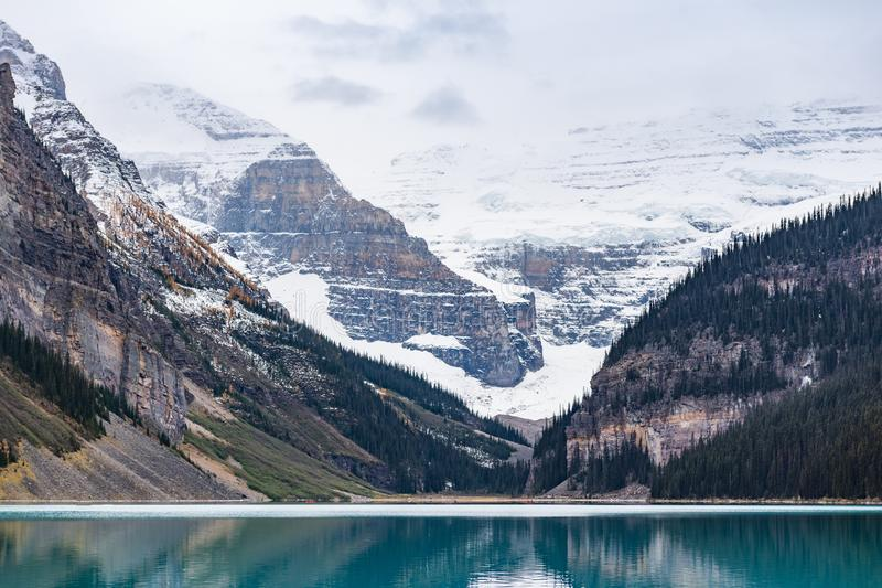 Lake Louise hiking in fall. Scenic Autumn views of the Lake Louise area and hiking PLAIN OF THE 6 GLACIERS in Banf National Park Alberta Canada royalty free stock photo
