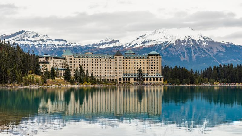 Lake Louise hiking in fall. Scenic Autumn views of the Lake Louise area and historic Chateau Lake Louise in Banf National Park Alberta Canada stock photos