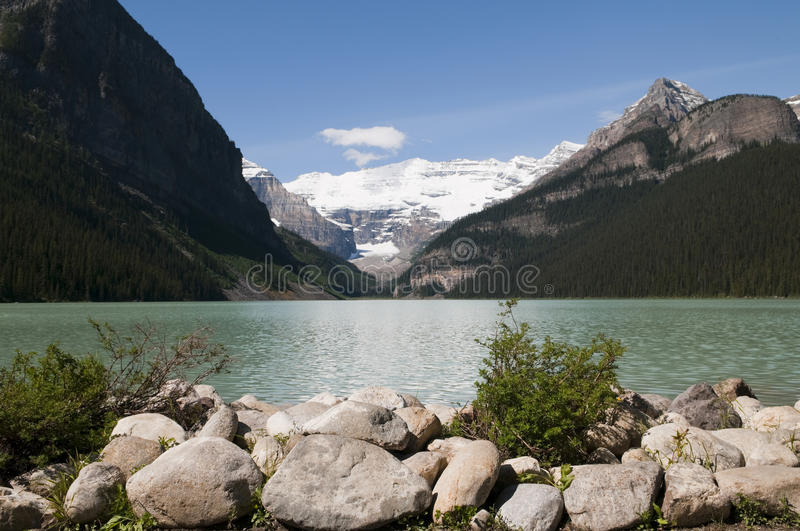 Lake Louise. Selective focus on the boulders in the foreground with the lake and the mountains in the background at Lake Louise, Alberta, Canada royalty free stock photo