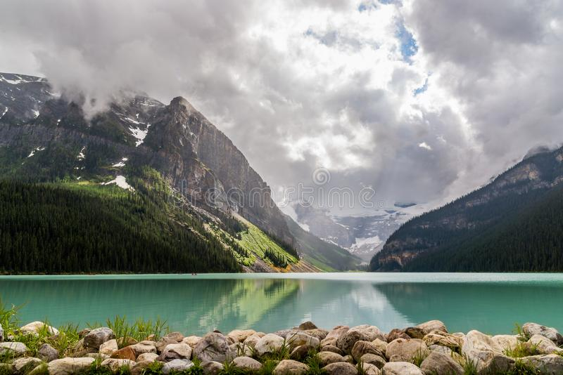 Lake Louise with stones in foreground stock photography