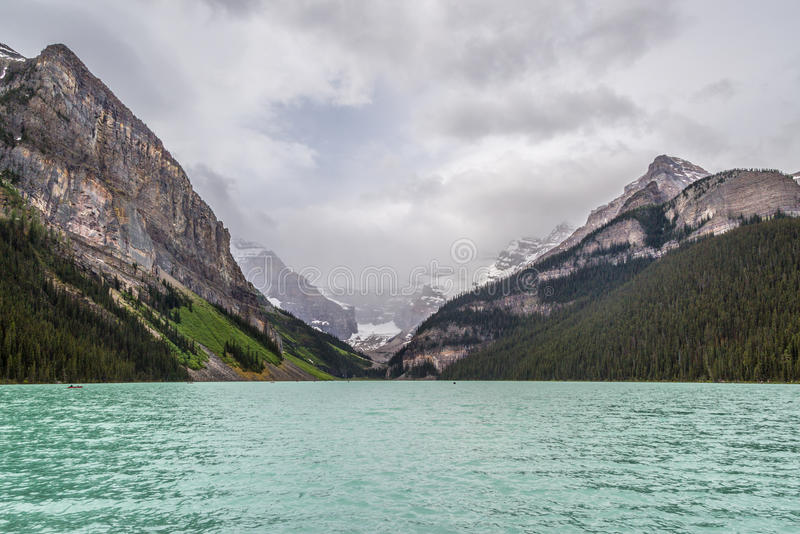 Lake Louise. Is a symbol of the Canadian mountain scene. This alpine lake, known for its sparkling blue waters, is situated at the base of impressive glacier royalty free stock photo