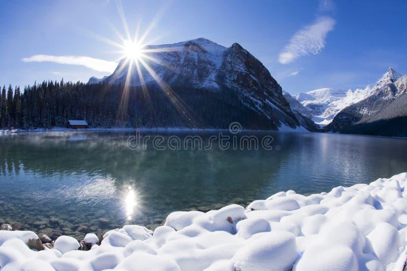 Lake Louise Winter Wonderland. Sun shining over Lake Louise, Alberta in the Canadian Rockies in winter stock photo