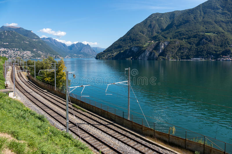 LAKE LUGANO, SWITZERLAND/ EUROPE - SEPTEMBER 21: Railway line ru. Nning alongside Lake Lugano in Switzerland on September 21, 2015 royalty free stock images