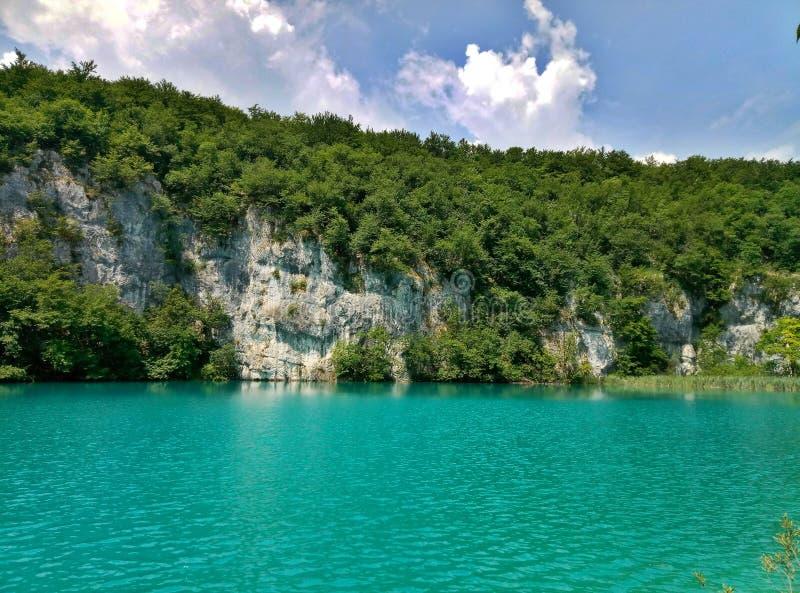 The lake with luminous azure-colored water. Greenery and rocks. Plitvice Lakes, Croatia stock image