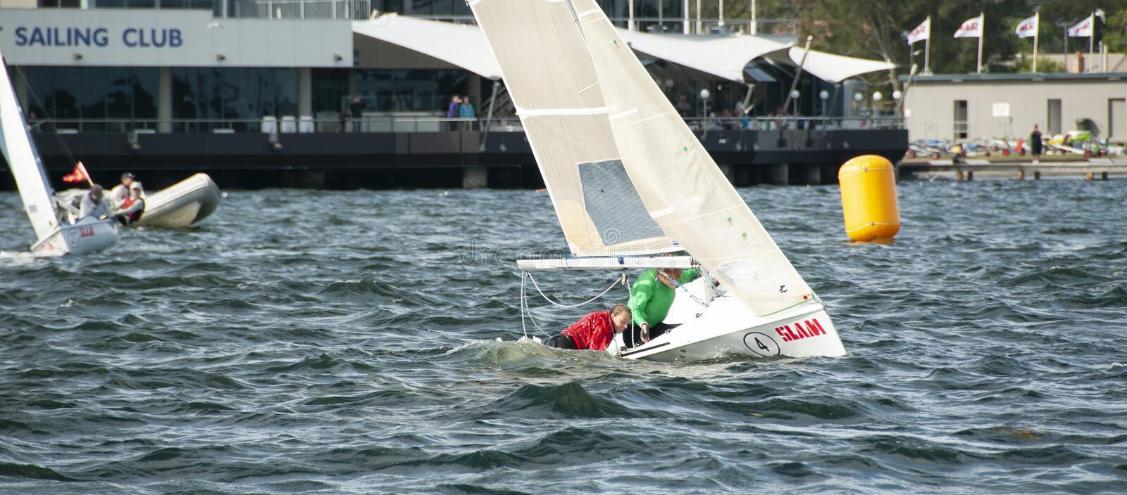 Girl overboard from racing dinghy. April 16, 2013: Editorial stock photography