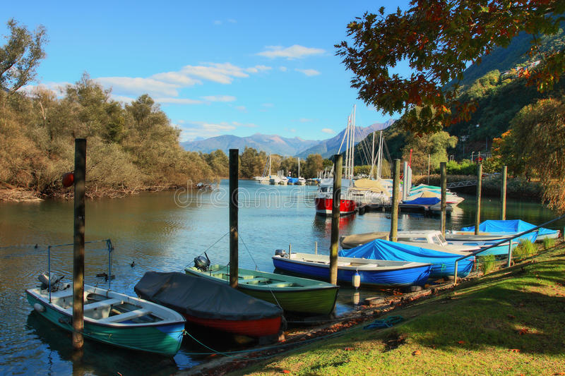Lake Maggiore. Fisherman boats and yachts on Lake Maggiore, Switzerland royalty free stock image