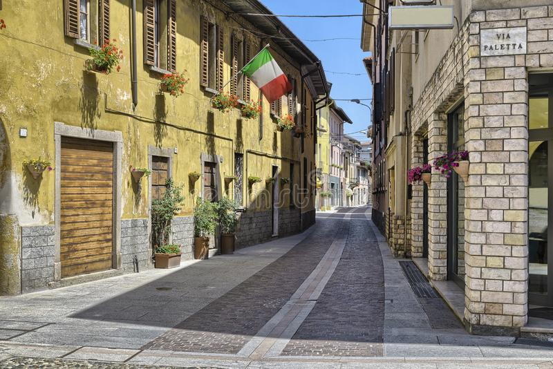 Lake Maggiore, Angera, Italy. Characteristic and picturesque alley street - via Greppi crosses the historic core of the village. Angera is known for the stock photo