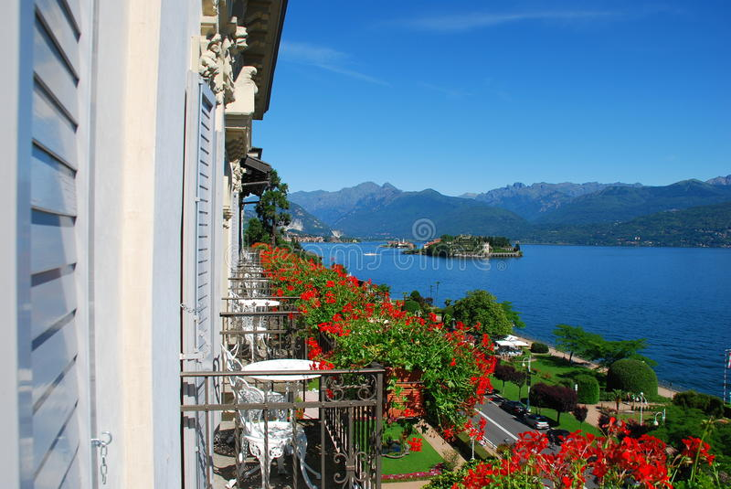 Lake Maggiore, Stresa, hotel view. The borromeo islands seen from an hotel balcony with flowers. Stresa, Lake Maggiore, Italy stock photography