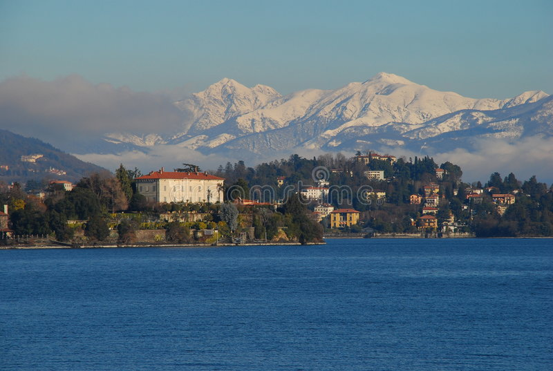 Lake Maggiore, Isola Madre. Italy. View of Isola Madre, Lago Magggiore in Winter. Snow covered mountains, Alps by Lake Maggiore, Italy royalty free stock photos