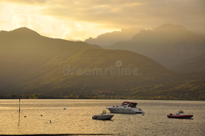Lake Maggiore, Italy: sunset and boats stock images