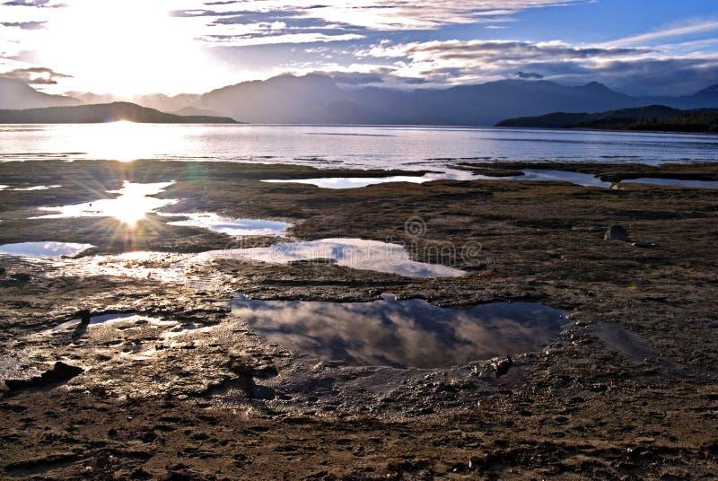 Lake Manapuri sun flare royalty free stock images