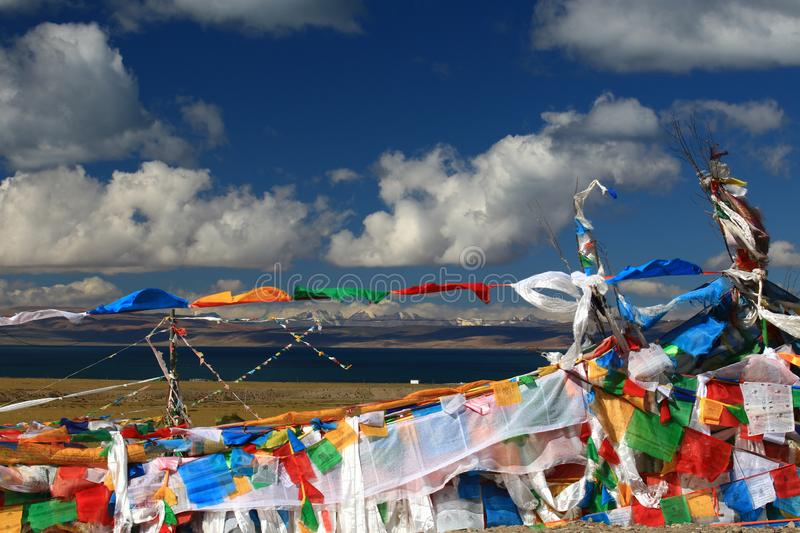 Lake Manasarovar and sutra streamers in Tibet royalty free stock image