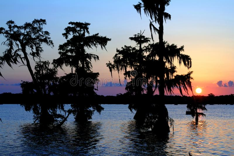 Lake Martin Sunset in Southern Louisiana. Sun Nestled in some clouds. Multicolored Sky stock photos