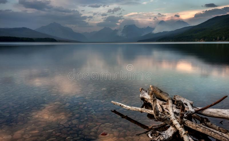 Lake McDonald in Glacier National Park with Sprague Fire in Dist royalty free stock images