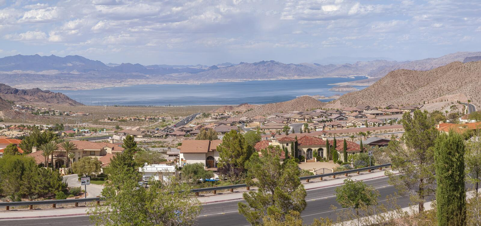 Lake Meade Bolder City Nevada suburb and mountains panorama. Boulder City Nevada suburbs and lake Meade with surrounding mountains panorama royalty free stock images