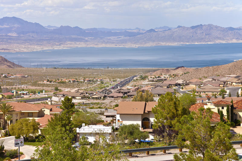 Lake Meade and Boulder city suburb NV. Lake Meade and Boulder city suburb with surrounding mountains Nevada royalty free stock images