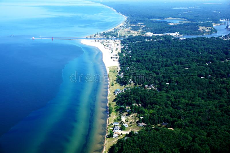 The Shore of Lake Michigan from a Bird's Eye View. The Shore of Lake Michigan from a Flying Plane. Coastline. Green Forests, Rivers and Houses. Transparent stock photos