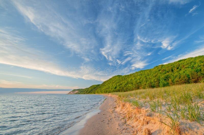 Lake Michigan Shoreline. Landscape of the shoreline of Lake Michigan with beautiful clouds near sunset, Sleeping Bear Dunes National Lakeshore, Michigan, USA stock image