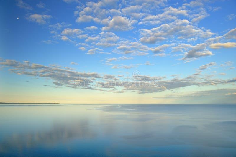 Lake Michigan at Sleeping Bear Dunes. Landscape of Lake Michigan, moon, and clouds, Sleeping Bear Dunes National Lakeshore, Michigan, USA stock photography