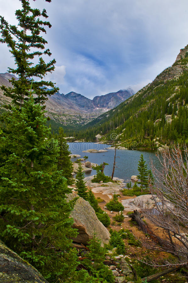 Lake Mills overlook. Mills Lake in Glacier Gorge from the trail to Black Lake. Long's Peak, Keyboard of the Winds, Pagoda Mountain and Spearhead visible in the royalty free stock photos