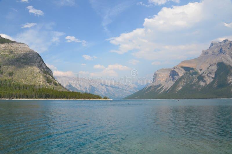 Lake Minnewanka in Banff. Lake Minnewanka, Banff, with mountains in background stock photo