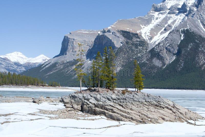 Lake Minnewanka and Canadian Rocky Mountains. Beautiful winter landscape with Lake Minnewanka and Canadian Rocky Mountains, Banff National Park, Alberta, Canada royalty free stock image
