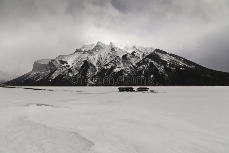 Lake Minnewanka. Frozen Lake Minnewanka in Banff National Park, Alberta stock image