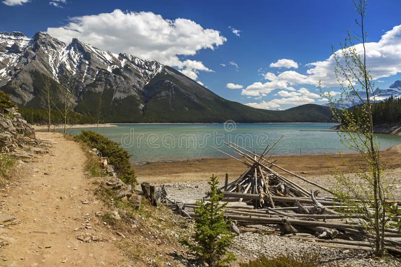 Lake Minnewanka Indian Teepee and Hiking Trail Scenic Landscape View Canadian Rocky Mountains Banff National Park stock photography