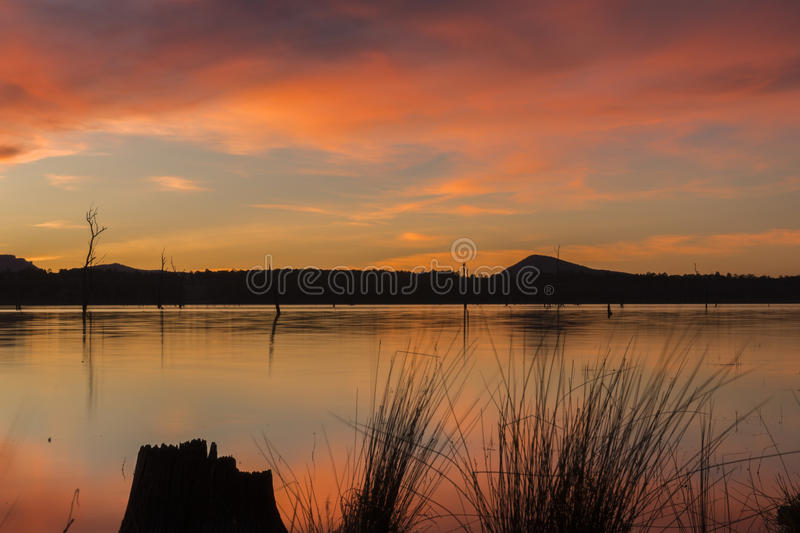 Lake Moogerah in Queensland with beautiful clouds at sunset. Lake Moogerah at sunset with beautiful clouds. Located on the Scenic Rim in Queensland royalty free stock images