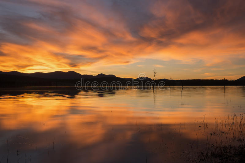 Lake Moogerah in Queensland with beautiful clouds at sunset. Lake Moogerah at sunset with beautiful clouds. Located on the Scenic Rim in Queensland stock photography