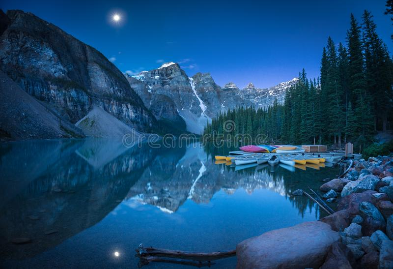 Lake with moon at 4:10AM. Photo taken at 4:10AM in Banff National Park royalty free stock image
