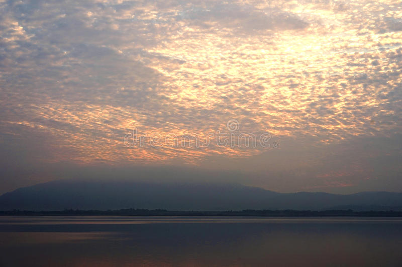Lake in the morning / sky covered with scatter cloud / mountain stock images