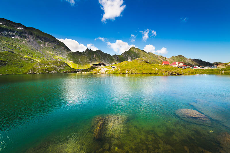 Lake and mountain (Balea Lake in Romania). Landscape from Balea Lake in Romania and Fagaras mountains in the summer stock photo