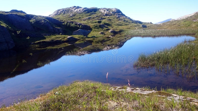 Lake on mountain stock photography