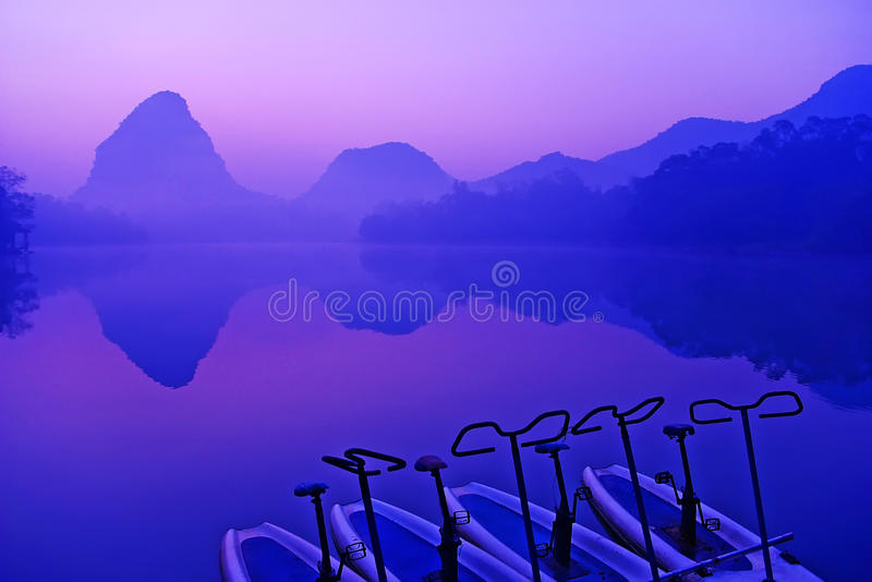 Lake and mountains. The early morning mist shrouded the lake stock photos