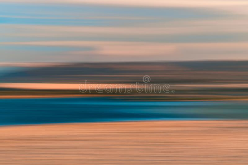 Sunset Abstract Background. Lake and Mountains, Motion Blur stock photo