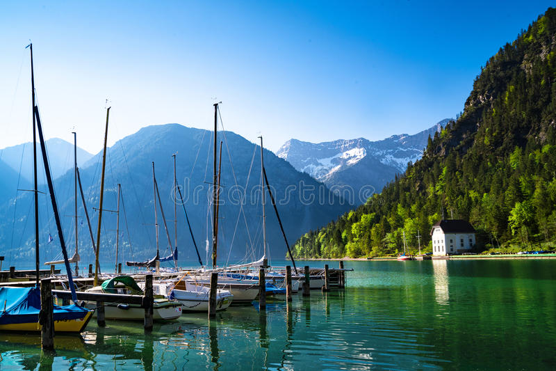 Lake with mountains and boats royalty free stock photos