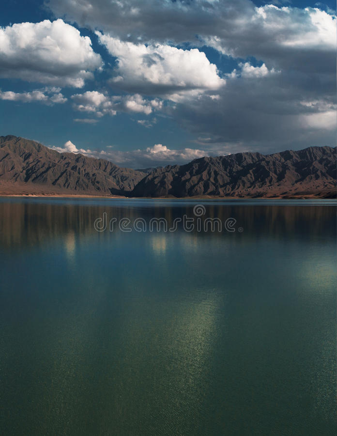 Lake in the mountains landscape (Bartogai reservoir), Central Asia royalty free stock photos