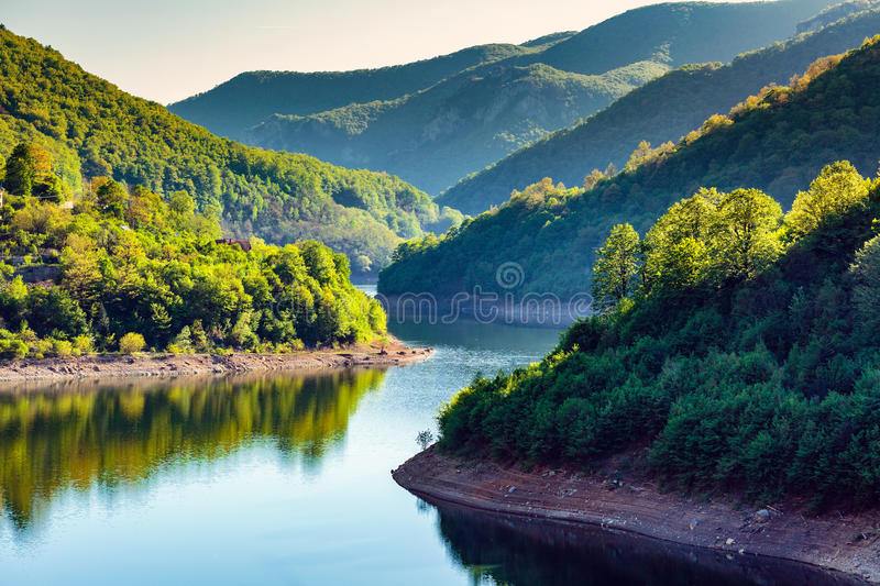 Lake between mountains royalty free stock photography