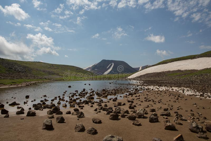 Lake At the mountains volcanic Lake. Volcanic Lake at the mountains Armenia Armenian mountains Ararat Mountains Geghama Mountains stock photography