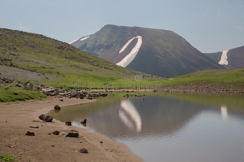 Lake At the mountains volcanic Lake. Volcanic Lake at the mountains Armenia Armenian mountains Ararat Mountains Geghama Mountains stock images