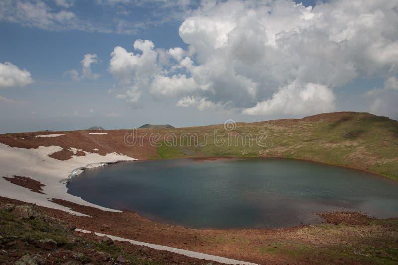 Lake At the mountains volcanic Lake. Volcanic Lake at the mountains Armenia Armenian mountains Ararat Mountains Geghama Mountains royalty free stock photos
