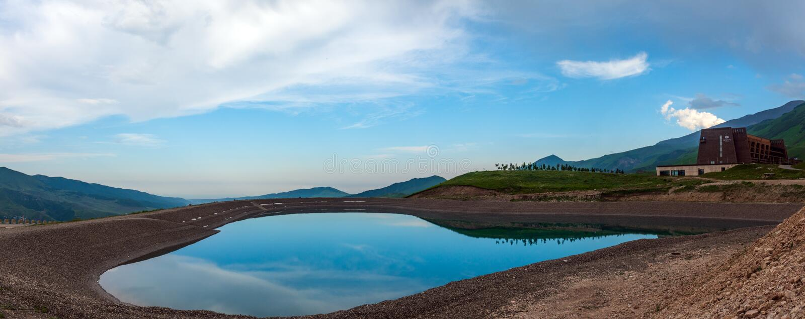 Lake near Shahdag hotel in the mountains, summer vacations and entertainment stock photo