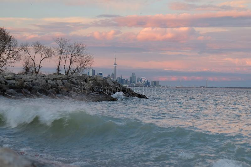 Lake Ontario at sunset with Toronto city skyline and CN Tower in the background. royalty free stock images