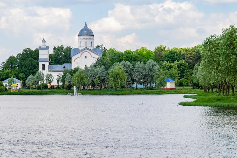 Lake and Orthodox Church in the Novobelitsky district of the city of Gomel. Gomel is the second largest city of the Republic of Belarus after Minsk. It has a stock photos