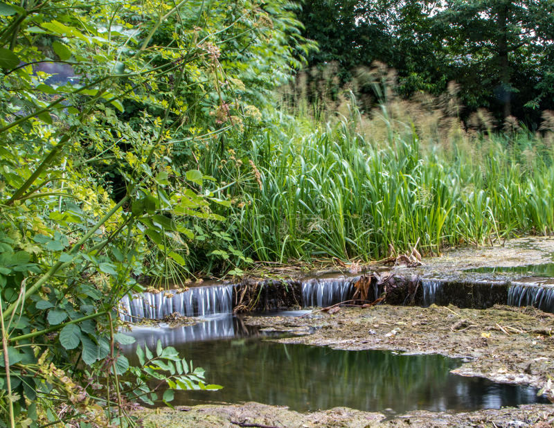 Lake overflow pipe stock image