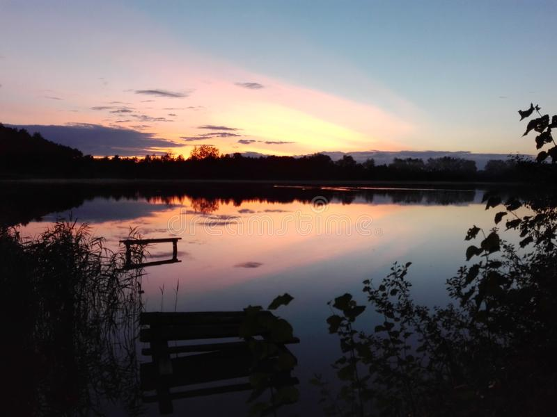 Lake på solnedgången arkivfoton