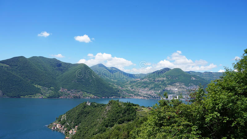 Lake panorama from `Monte Isola`. Italian landscape. Island on lake. View from the island Monte Isola on Lake Iseo, Italy.  royalty free stock images